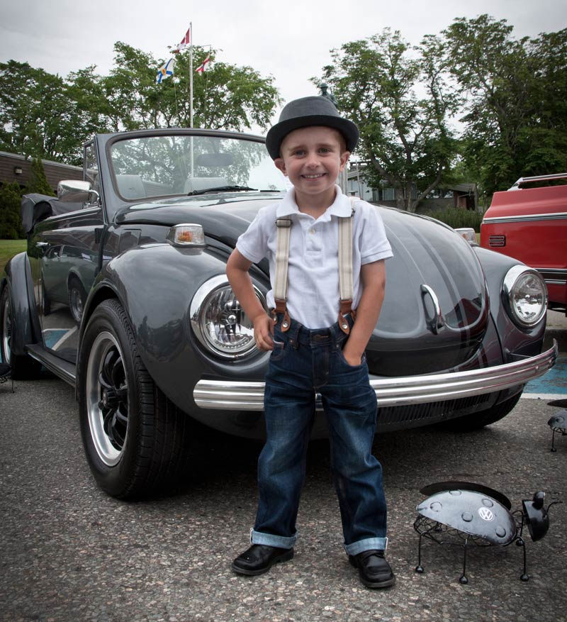 Young Boy in Front of a Car